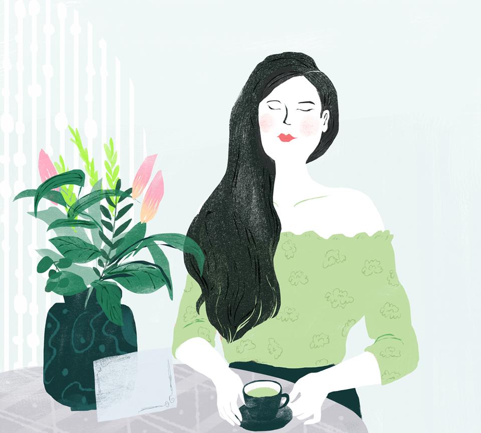 緑茶を飲む女性