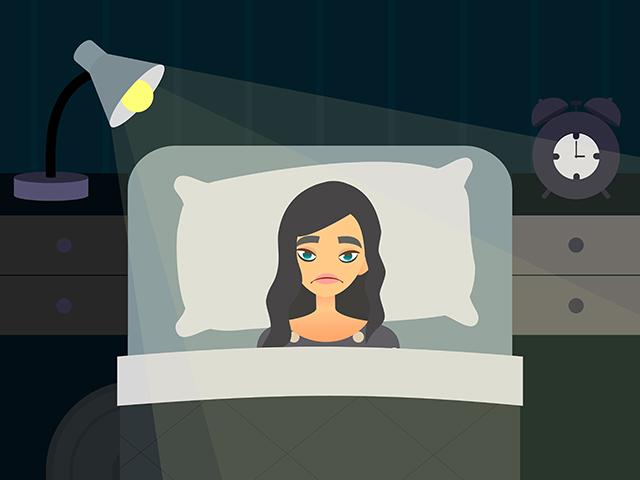 照明をつけたままのベッドルーム