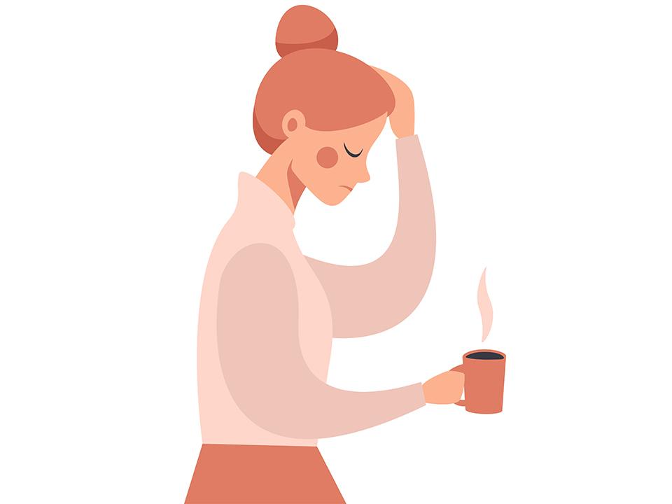 風邪気味で頭痛がする女性