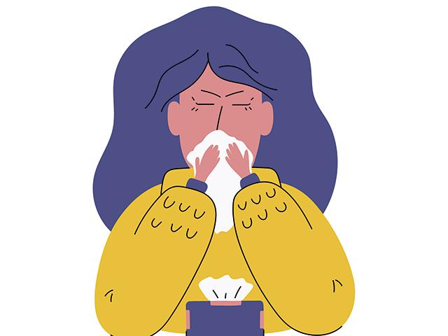 風邪を引く女性