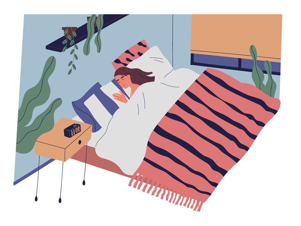 22時にベッドで眠る女性