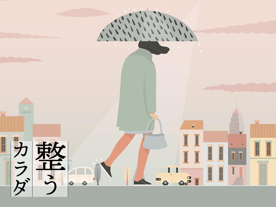 雨の中歩く女性