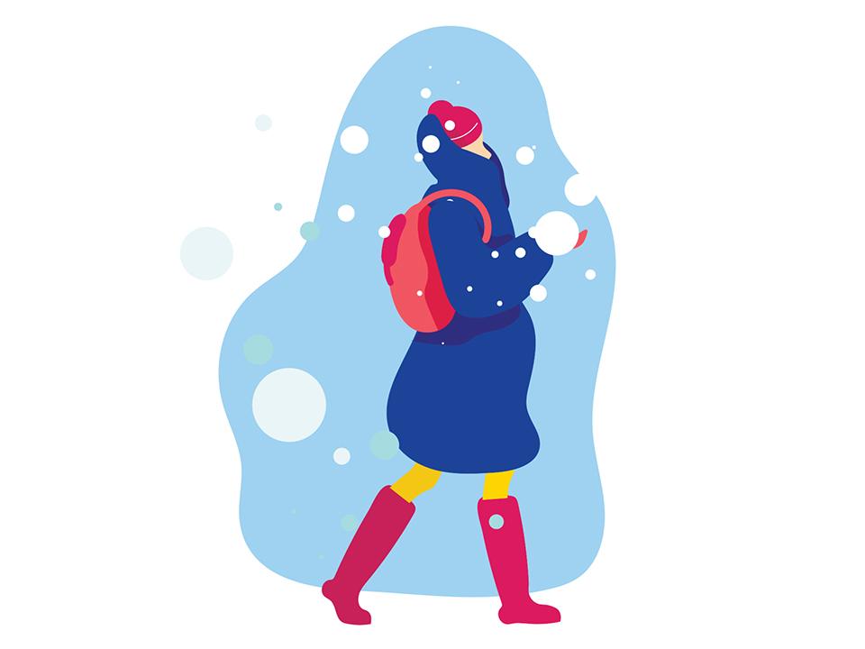 雪の中にいる厚着をした女性