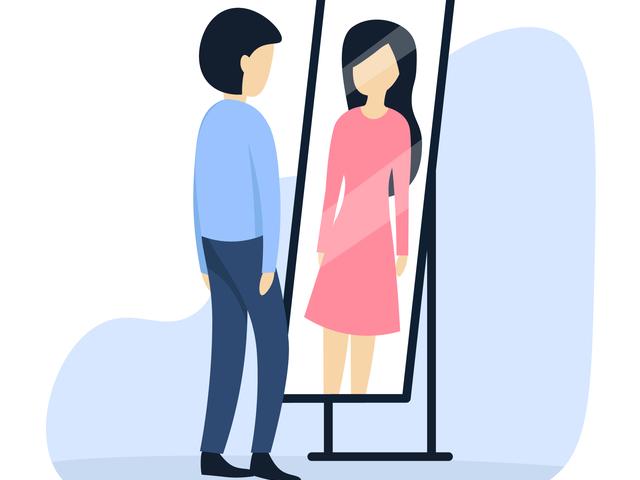 鏡に映る女性を見る男性