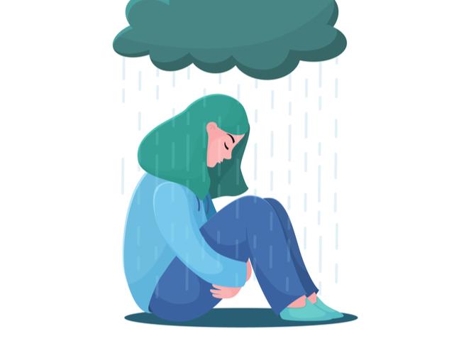 雨に降られる女性