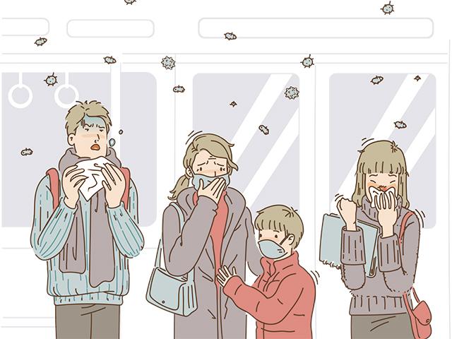 風邪をひいて電車に乗っている人