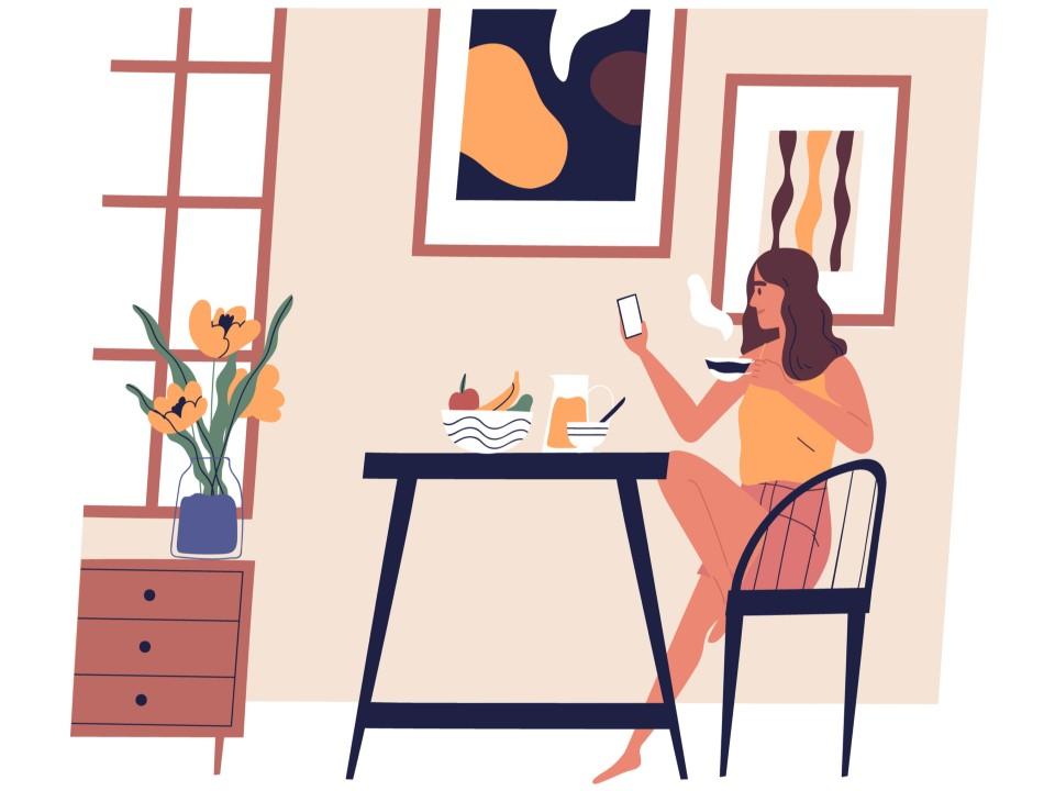 お茶をしながら携帯を見る女性