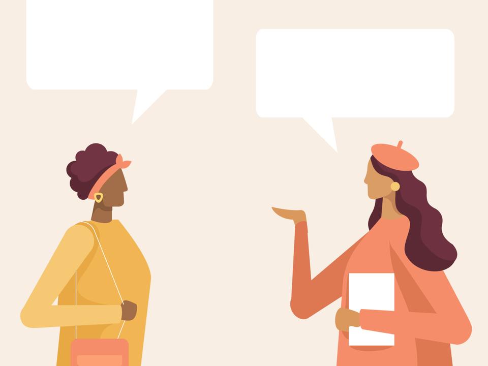 女性が2人で会話している