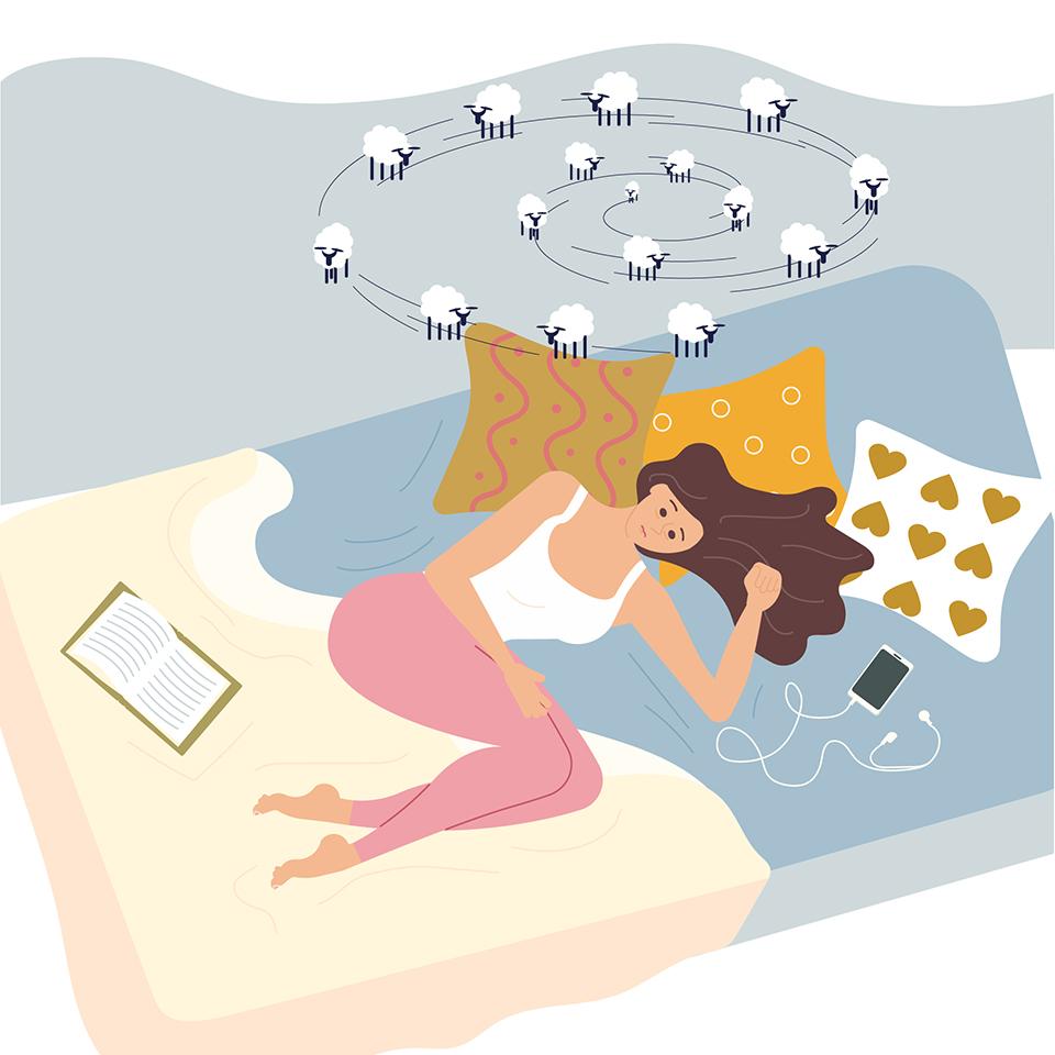 不調でベッドに横たわる女性