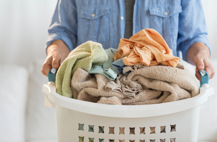 Man Holding Laundry Basket At Home