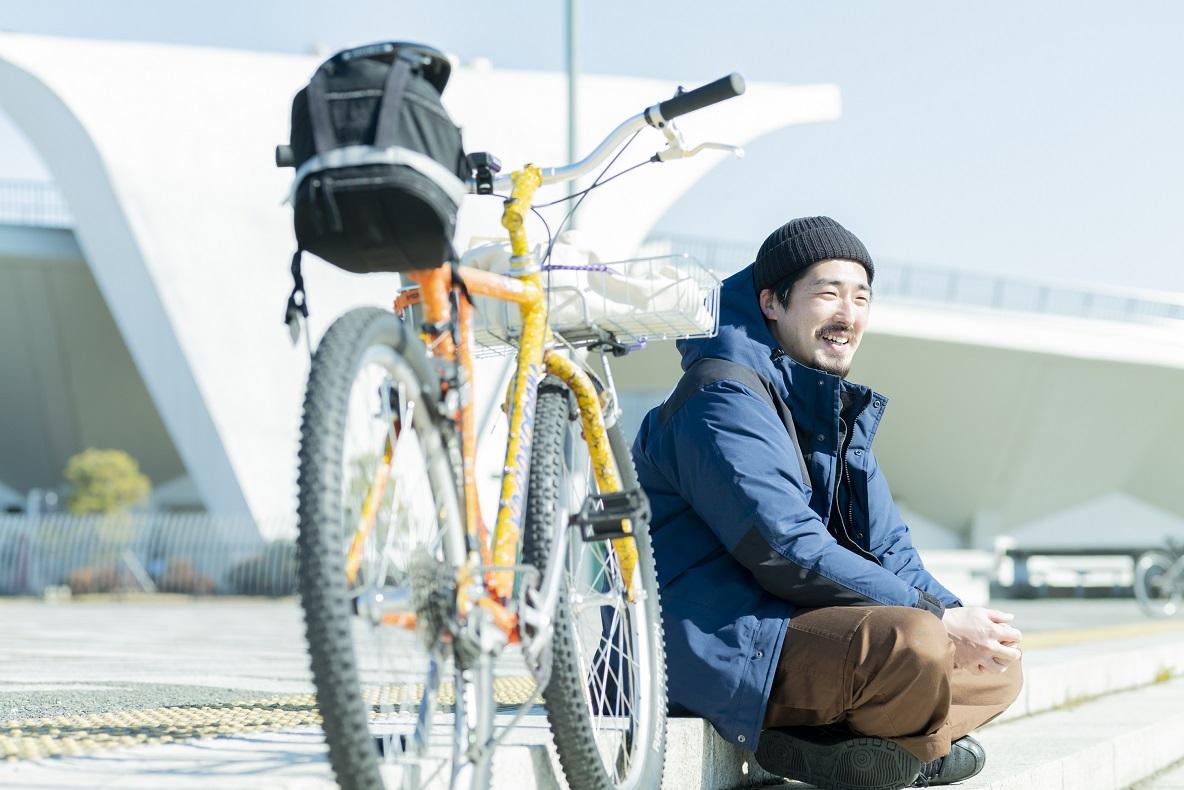 自転車越しの木村さん