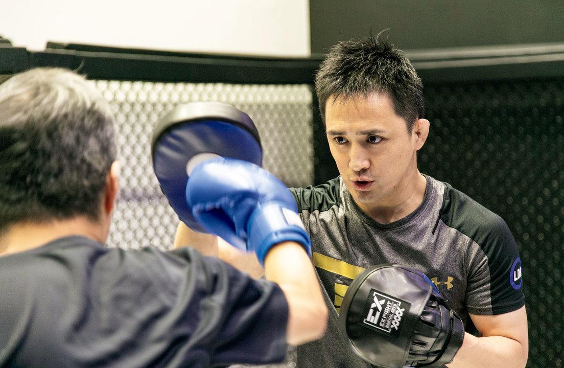 石田光洋さん(いしだ・みつひろ)/1978年生まれ。元修斗環太平洋ライト級王者。修斗、PRIDEなどで活躍し、「新・青春のエスペランサ」の称号を持つ。引退後、EXFIGHTトレーナーを務める。